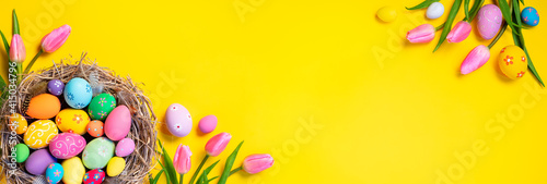 Easter - Decorated Eggs In Nest With Pink Tulips In Yellow Background