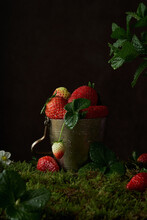 Composition With Fresh Ripe Red Strawberries With Mint Leaves Placed In Metal Bowl On Dark Background