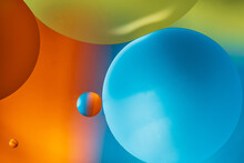 Closeup Of Abstract Background With Round Shaped Cells Of Vaccine Of Different Sizes Illuminated By Colorful Light