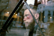 Side View Hipster Man With Beard And Cinema Makeup Posing On The Street