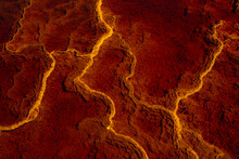 Majestic View Of Orange Rock In River With Fast Flow In Long Exposure In Minas De Rio Tinto