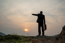 Businessman Standing On Mountain At Sunset Background,Business S