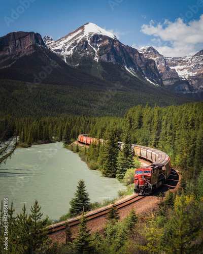 Canvas Print The Canadian Pacific Railway thunders around Morants Curve in Banff National Park during the Summer