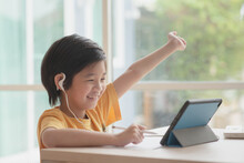 Cute Asian Child Learning Class Study Online With Video Call From Tablet