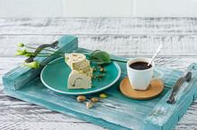 Morning Breakfast - Sliced Pistaschio Halva With Cup On Coffee On A Blue Wooden Tray With Flowers