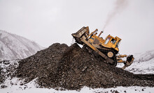 Bulldozer In  Process Of Working In An Industrial Mountain Area