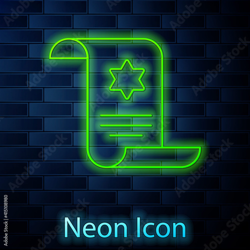 Photo Glowing neon line Torah scroll icon isolated on brick wall background