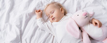 Overhead View Of Little Child Sleeping With Toy Bunny, Banner