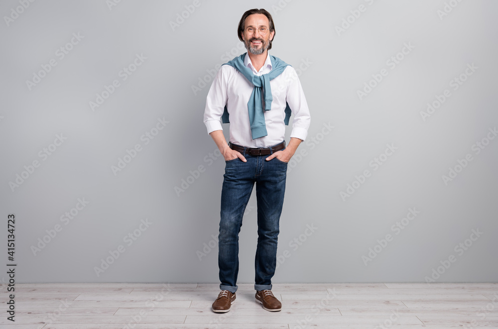 Fototapeta Full length body size photo of man wearing white shirt jeans brown shoes spectacles isolated on pastel grey color background