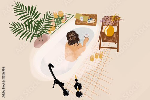 Fotografering Beautiful woman lying in a bath with steam near palm, candles, flowers and a glass with cacao