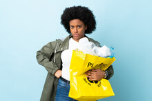 Young African American Woman Holding A Recycle Bag Isolated On Colorful Background Angry