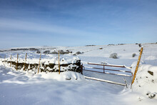 Heavy Snow Rests On The Ornamental Gate Leading To Pastures On The Yorkshire Moorland At 900ft