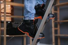 Person Climbing Ladder Indoors, Closeup On Feet