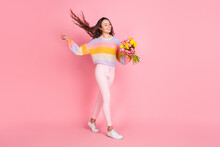 Full Length Body Size View Of Attractive Cheerful Girl Holding Bunch Fresh Tulips Step Stroll Isolated Over Pink Pastel Color Background