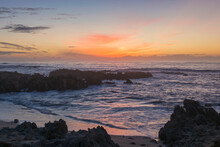 View Across The Pacific Ocean From Rocky Coastline Of The Monterey Peninsula, Sunset, Pacific Grove, Monterey, California