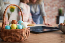 Close Up Of Wicker Basket Full Of Easter Eggs