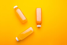 Photo Of Three Bottles With Detox Juice, Orange Lemon Carrot Pineapple.