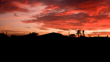 Bloody Red Sunset Sky With Silhouette Background Wallpaper