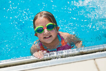 Little Girl Taking A Break During Swimming Swim Lessons At The Local Outdoor Pool