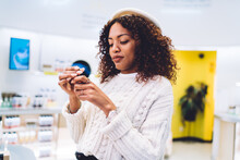 Content Black Woman Choosing Products In Beauty Store