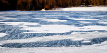 Winter With Snow And Frozen Lake At Nathaniel Cole Park In Harpursville In Broome County In Upstate NY.  Wind Blows Snow Across Lake And Land This Clear Winter's Day.