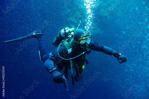Fototapeta Scuba diver in the middle of bubbles obraz