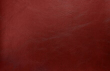 Close Up Dark Red Leather Texture Background. Abstract Retro Concept Background. Top View Of Genuine Leather.