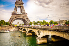 Paris Eiffel Tower Reflecting In River Seine With Bridge Pont DIena In Paris, France. Eiffel Tower Is One Of The Most Iconic Landmarks Of Paris