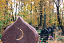Golden Muslim Crescent Moon On A Granite Tombstone. Islamic Grave With Half Moon In The Autumn Cemetery