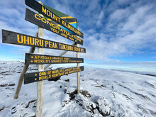 """Information Desk """"Congratulations You Are Now At Uhuru Peak 5895m"""" Kilimanjaro Stratovolcano Crater Mount - The Highest Point Of Africa And The Highest Single Free-standing Mountain In The World."""
