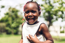 Portrait Of Happy Smiling Little Child African American Girl In Park