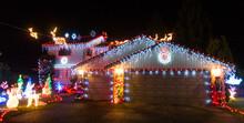 Enthusiastic Christmas Lights On A Suburban House