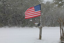 American Flag On Mailbox, Waving In The Snow