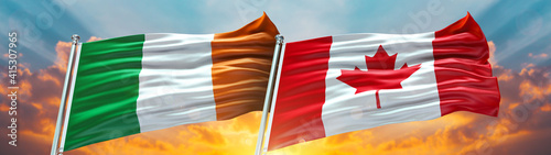 Photo Ireland Flag and Canada flag waving with texture sky Cloud and sunset Double fla