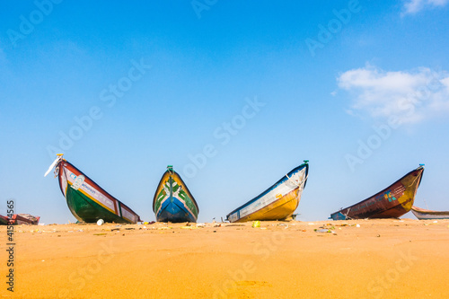 Fototapeta Fishing boats on land with clear blue sky background obraz