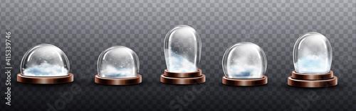 Fotografie, Obraz Realistic glass domes with snow, christmas globes