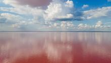 Amazing Panoramic Landscape Of Beautiful Salt Plains. Pink Lake. Bright Red Salt Deposits In Artificial Salt Evaporators, Salt Mining.