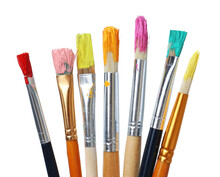 Different Brushes With Paints On White Background