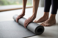 Woman Rolling Up Exercise Mat And Preparing Doing Yoga Or Fitness. Home Workout, Yoga, Balance, Meditation, Relaxation, Healthy Lifestyle, Self-care, Sport, Training Class, Body Care, Pilates Concept