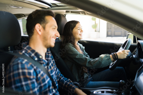 Leinwand Poster Good-looking dad and teenage girl driving together