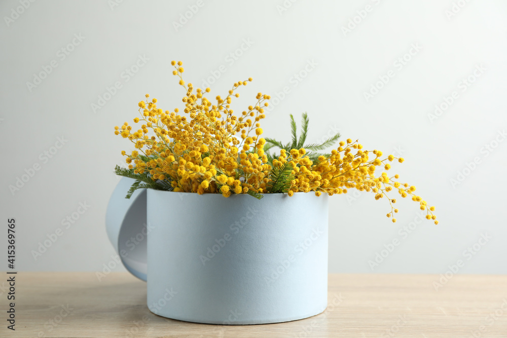 Fototapeta Bouquet of beautiful mimosa flowers on wooden table