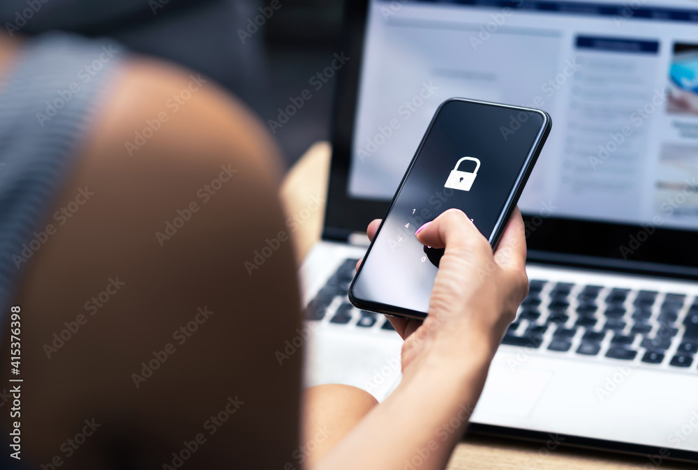 Fototapeta Phishing, mobile phone hacker or cyber scam concept. Password and login pass code in smartphone. Online security threat and fraud. Female scammer with cellphone and laptop. Bank account security.
