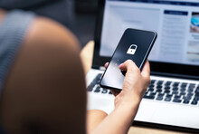 Phishing, Mobile Phone Hacker Or Cyber Scam Concept. Password And Login Pass Code In Smartphone. Online Security Threat And Fraud. Female Scammer With Cellphone And Laptop. Bank Account Security.