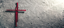 Three Red Nails In Shape Of Cross On Dirt Floor - Crucifixion Of Christ
