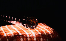Marble Ball On A Red Textile Surface