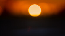 Orange Disc Of The Setting Sun, Blurred Background.