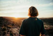 Caucasian Male Free Spirit Walking Through Wilderness Embracing Sunrise