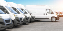 Delivery Vans In A Row With Space For Logo Or Text. Express Delivery And Shipment Service Concept.