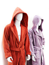 Colored Terry Robes On A Mannequin Isolated White