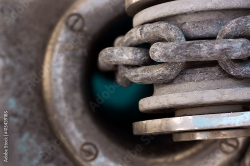 Fototapeta Vessel chain close up on windlass anchor winch capstan